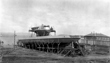 A ferry under construction on the waterfront looking west.