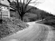 Dirt Road and House with Stone Foundation