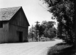 Barn on Bank of Dirt Road
