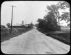 Gravel road by farm