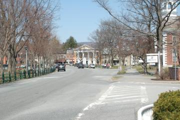 Picture of a street with the town common on its left