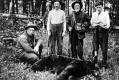 Hunters With Bear