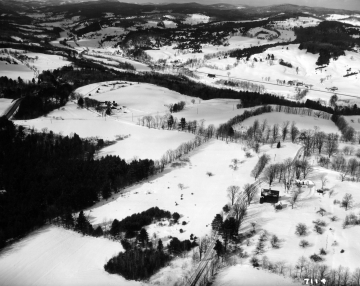 Aerial View of Snow Covered Farm Fields