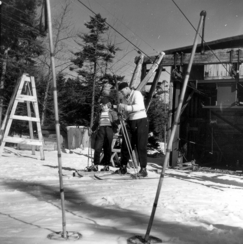 Skiers getting on a T-Bar, circa 1956. | Photo UVM Landscape Change Project.