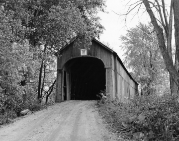 Dirt Road Approaching a Covered Bridge