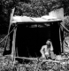 Armand Seigle in a makeshift shelter