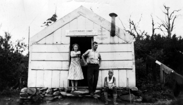A girl, a man and a boy outside Glastenbury Camp
