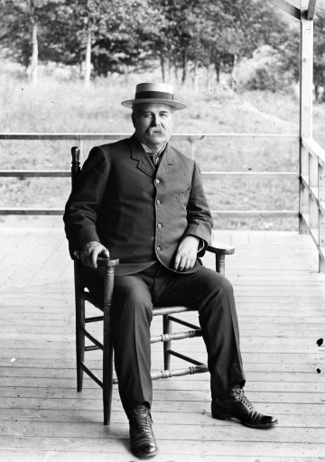 Admiral Clark on Porch of the Lake Mansfield Trout Club