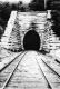Train Tracks Toward a Tunnel