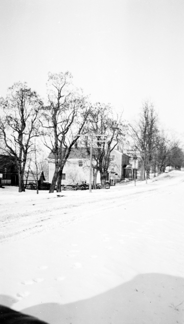 Buildings in Snow-Covered Landscape