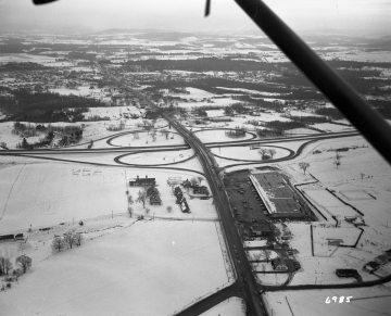 Aerial View of Burlington Area: Highway Next To Large Industrail Building in Winter