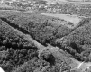 Aerial of forested hill and Norwich University