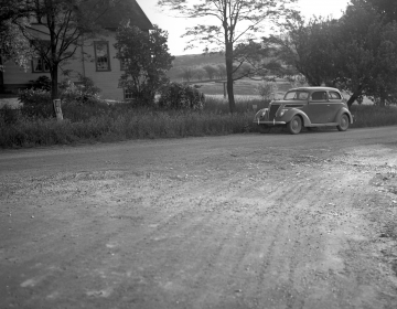 A Home and Car on Dirt Road