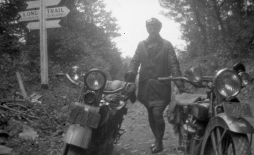 A Man with Two Bikes on the Trail