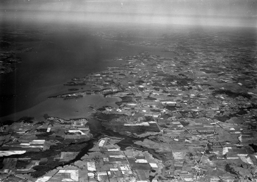 Aerial Photograph of farmland and a body of water