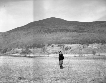 A man in front of Potato Hill