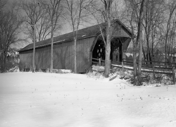 A covered bridge in the winter
