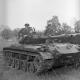 Army men on a tank