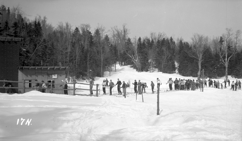 Skiers waiting in line. Sometime vaguely between 1930-1950. | Photo: UVM Landscape Change Program