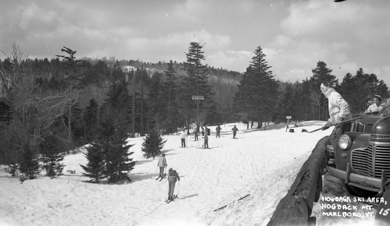One of my favorite images I found of Hogback. Love the front of those old cars parked along Route 9, with equipped skiers ready to ride. The hill was literally along the roadside. | Photo: UVM Landscape Change Program.