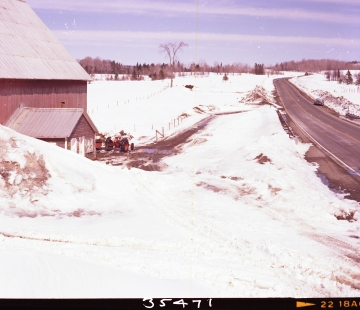 Barn by Paved Road