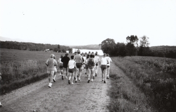 A group of runners on a dirt road