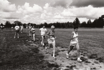 A group of runners running through a field